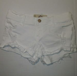White Hollister Low Rise Distressed Short Shorts